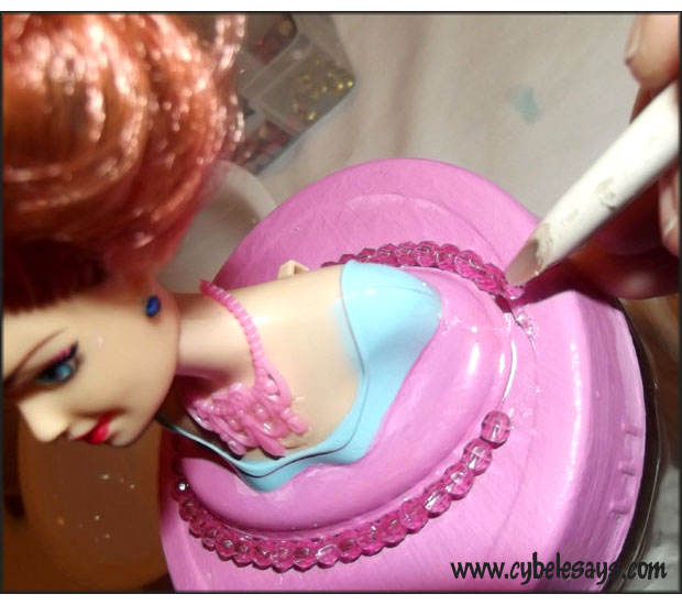 Applying-Swarovski-crystals-to-the-pink-Barbie-Bust