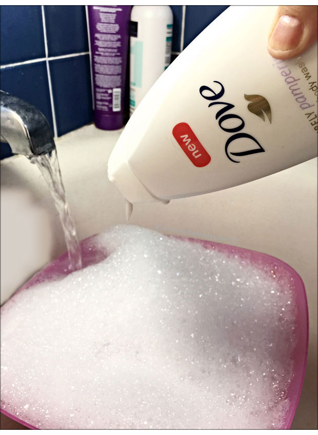 Dove-Purely-Pampering-Sweet-Cream-and-Peony-Body-Wash-going-into-the-water