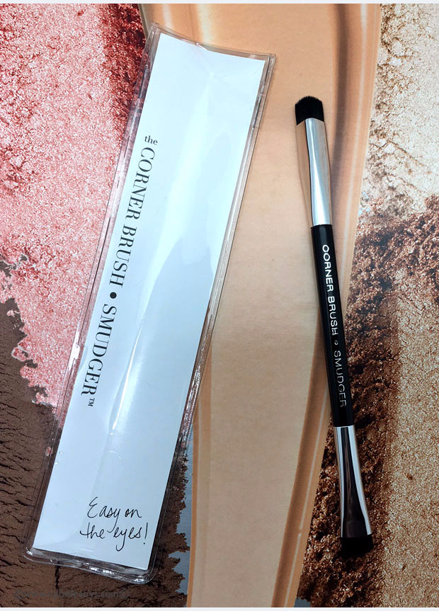 The Corner Brush Eye Stamper has a v-shaped brush on one side that you dip in shadow and stamp where you need the guidance on the eye, at the corner or a little above. Check out this full review and tutorial.