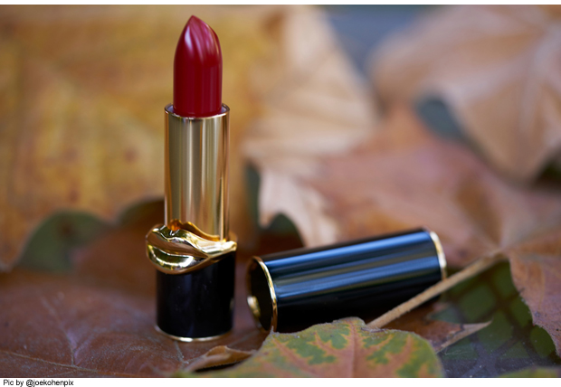 Pat-McGrath-Labs-LuxeTrance-Lipstick-in-Major-Red-on-table