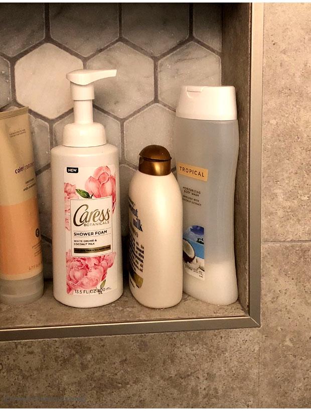 Caress-Shower-Foam-in-White-Orchid-&-Coconut-Milk-in-shower
