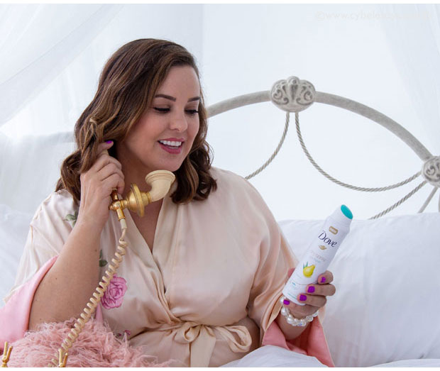 Cybele-on-the-phone-in-bed-with-Dove-Dryspray-Deodorant