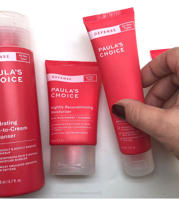 Paula's-Choice-DEFENSE-Skin-Care-Collection-in-hand